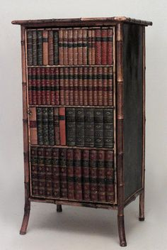English Victorian bamboo and black lacquered small bookcase cabinet with leather book binding design on door (late 19th/early 20th cent.)