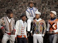 Geometric knits by Ngxokolo. The coming of age of young men in the Xhosa culture is marked by traditional events to which boys wear geometric knitwear. Ngxokolo has created an award winning collection of knits inspired by traditional Xhosa beadwork. Kitenge, African Men Fashion, Mens Fashion, Fashion Menswear, Mode Statements, African Traditions, New Yorker Mode, Style Ethnique, Native Style