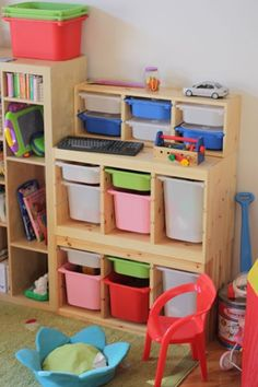 "Storage ideas for toddler room.  Ikea Trofast units.  Small unit on top (with blue & white bins) is actually the wall storage unit that sells for $34.99 w/o the bins.  Dimensions are 36.5"" W x 11.75"" H x 8.25"" D. storage ideas for toddler bedroom"