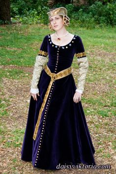 14th century medieval gown. This is a female cotehardie, made of velvet and silk with beaded details and handmade buttons. The hat is a tressour crispinette, made of silk with pearls.
