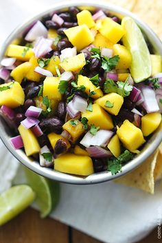 Fresh mango and black bean salsa - it just takes a few ingredients to whip up this quick, healthy, and TASTY appetizer!