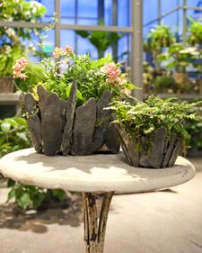 Make your own planter using stones and cement.  I do love stones in my garden!