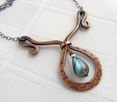 Copper and Labradorite Teardrop by Ruth Jensen, via Flickr  Like the stamping on the wire