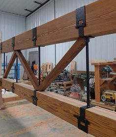 Wooden beam with forged steel construction parts