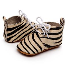 Children's genuine leather pony hair oxfords in zebra print. Featuring white laces and pull tab for ease of wear. Soft suede sole allows for natural foot movement, essential for foot health and natural development in little bebes.   #kidsshoes #girlshoes #babyshoes #babyfashion #kidfashion #printedshoes #zebraprint