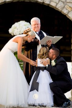 Bride, groom, and daughter during wedding ceremony...can't wait for Ava to be a part of the special day!!!