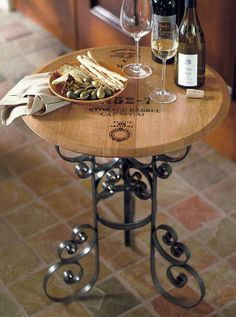 Handcrafted from the lid of an authentic French oak barrel, our Reclaimed Wine Barrel Tasting Table retains the distinct character of its original cask and is sure to be a conversation piece at your next wine tasting.