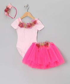 Everything's coming up roses and butterflies thanks to this petal soft set. With shabby chic fringe detail on the floral-accented headband, a snug elastic waistband and fluttery tulle layers on the tutu and comfy stretch on the leotard, this ensemble is fit for any fairy princess.Includes headband, leotard and tutuHeadband: .25'' W x 13.5'' L