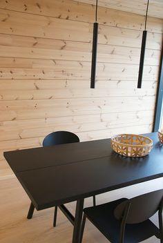 Natural wood and black details. Hakola Woody dining table. Honka showhouse Markki.