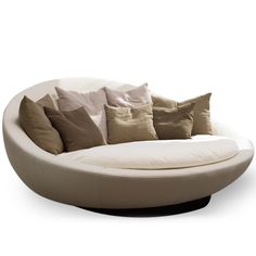 """Enveloping and curvy, soft and fun-loving, Lacoon is an """"island"""" made to relax on. The Lacoon island is an extension of the collection that already includes a sofa and an armchair. A swivel version and..."""