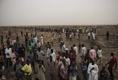 Tens of thousands of South Sudanese people line up for the first food distribution administered by the International Committee of the Red Cross since the fighting stopped in Leer and a tentative peace is holding in Unity State, South Sudan, on March 17, 2016.  When fighting raged throughout Leer in 2014 and 2015, most of the population fled, leaving civilians unable to harvest crops and many struggling to find food. The city of Leer, once a bustling city and headquarters of opposition…