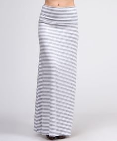 Long, lean and effortlessly lovely, this marvelous maxi is a perfect pick. Boasting a flattering, feminine fit and subtle stretch from spandex, this sleek skirt embodies easy eleganceMeasurements (size M): 40'' long95% rayon / 5% spandexMachine washMade in the USA