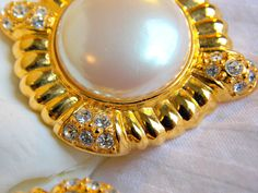 givenchy vintage pearl & rhinestone earrings, clip on, Pearl, gold tone, signed vintage by MetalsmithMage on Etsy