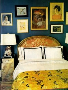 Kate Spade's bedroom: deep blue & gold with white linen, gallery wall