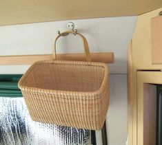 basket and hooks storage idea from rv forum