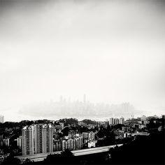 Skyline in the Fog, Chongqing, China by Martin Stavars