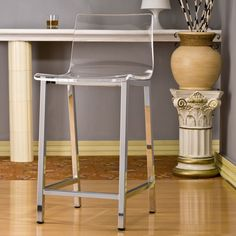 """This set of two sleek acrylic counter stools will add a contemporary style to any setting."""
