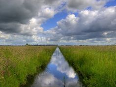 clouds over a typical Dutch countryditch