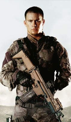 Channing Tatum something about a man in uniform with a big gun!!!! gorgeous!!