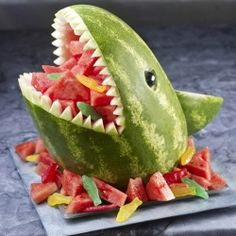 25 Totally Clever Kid's Party Ideas, like fun games, activities and serving tips - serve fruit inside a watermelon shark (via Watermelon).