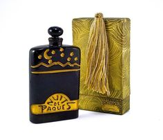 1928 Depinoix, Benoit Nuit de Paques perfume bottle and stopper, black glass, gilt intaglio label and decoration, tassel box. 4 3/8 in.