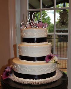 A classically beautiful white wedding cake with purple accents. rockwallchapel.com
