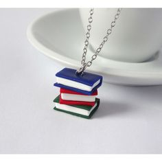 Book necklace stack blue red green books charm pendant ($15) ❤ liked on Polyvore featuring jewelry, pendants, green charm, charm jewelry, red charms, blue green jewelry and pendant charms