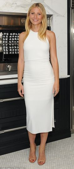 White lady: Gwyneth Paltrow wore a form fitting frock showing off her svelte frame to the book event in Los Angeles of interior designer Windsor Smith on Monday