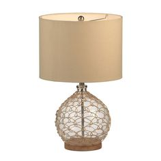 Glass table lamp wrapped in metal netting and featuring a drum shade.     Product: Table lampConstruction Material: G...