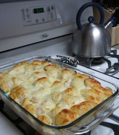 CHICKEN ALFREDO BUBBLE UP-- A comforting casserole full of Biscuits- Alfredo Sauce- Chicken and you can add ham/swiss cheese! The best part it stay's nice & moist for leftovers!! If there is any left!! Woowza Yum!!