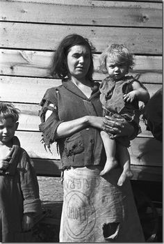 The Great Depression: Mother and baby from a family of nine living in a field.