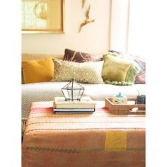 We love using a hand-stitched kantha quilt to dress up a tired ottoman.