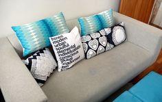white black turquoise pillows