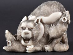 A MEIJI PERIOD IVORY CAT - amazing evil expression. indeed, the cat looks a little rat-like!