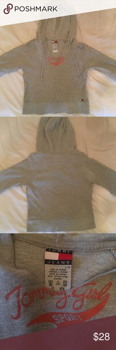 """Tommy Jeans Hooded Top tommy jeans hooded grey top. says """"tommy girl sport"""" in orange. not cropped but fits slightly shorter. 3/4 sleeves. marked a size large, would fit a small-large. in perfect condition! 10% off bundles of 2 items and 15% off bundles of 3+ items. item is cheaper on my depop & mercari @jillianalice Tommy Hilfiger Tops Sweatshirts & Hoodies"""