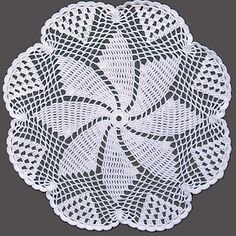 Pinwheel Doily Crochet Pattern Vintage 1950s  The pattern motif is an attractive eight point spinning pinwheel motif.   It is worked in single, double and triple crochet.