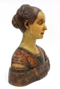 Florentine terra cotta bust of a lady, 19th century, the polychrome decorated sculpture adorned in traditional attire and rising on a bronzed plinth having a relief decorated frieze, the interior marked A2034, 18''h x 19''w Provenance: The Montclair Art Museum (Montclair, NJ) deaccession