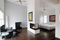 Look at how stunning it is to have a double-sided fireplace in the bedroom.