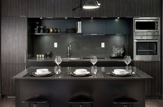 Picasso Model Suite Kitchen. Absolutely loving this dark on dark kitchen. So sophisticated and very trendy.