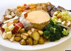 Fondue party set up. Potatoes, broccoli, apple, beef, chicken, bread, etc.