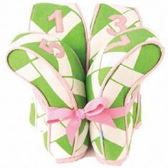 Pink & green golf club covers.
