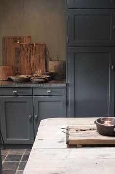 soft deep country blue kitchen with beautiful soapstone counter -article on Kitchen Styling & Living showroom