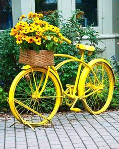 Yellow bicycle with black eyed susans Dishfunctional Designs: The Upcycled Garden Volume 7: Using Recycled Salvaged Materials In Your Garden