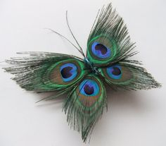 "@Jessica Olson Gibson look at  This gorgeous butterfly hair clip was made using 4 small lightly trimmed peacock feathers and 3 teal blue crystal beads. It can be worn many different ways in the hair or clipped on whatever you would like. It is approx. 5"" wide by 2.5"" tall and fits securely in hair with a 1"" alligator clip"