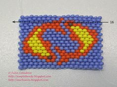 Free detailed tutorial with step by step photos on how to make a keychain with zodiac sign Pisces out of seed beads in the brick stitch bead weaving technique. Great for beginners!