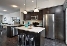 Bramley Townhome Showhome - Gateway at Williamstown in Airdrie Alberta Townhouse, Kitchen Cabinets, Table, Furniture, Design, Home Decor, Small Kitchens, Decoration Home, Terraced House