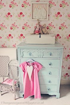 aqua dresser..pink little girl's dress..child's white rocking chair...vintage..floral wallpaper...