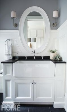 new england style bathroom cabinets. more new england style bathrooms. see more. a farmer\u0027s sink is practical addition to the mudroom. architecture by e. ronald bathroom cabinets n