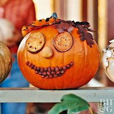 For a sweetly smiling pumpkin, use dried fruit, berries, leaves, and other natural elements to create a face. Simply plan your design then hot-glue the objects in place.