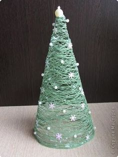 CHRISTMAS: DIY Christmas tree: cover cone with saran wrap, wrap with yarn, slather with Elmer's glue, dry, take away cone. Cone Christmas Trees, Winter Christmas, All Things Christmas, Christmas Holidays, Christmas Decorations, Christmas Ornaments, Xmas Tree, Ball Decorations, Christmas Lights